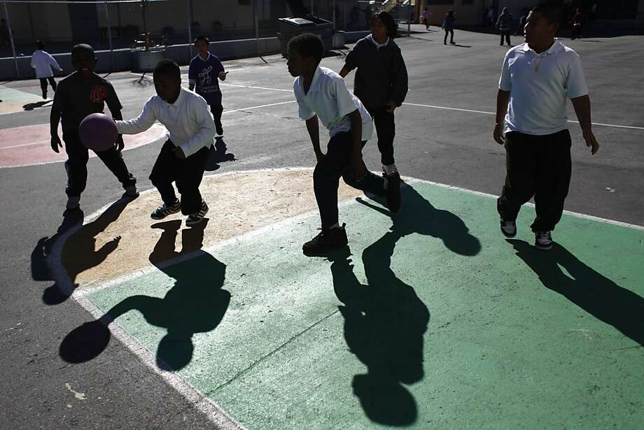 A file photo of school children at E.R. Taylor Elementary School play basketball during recess. Administrators at the school decided to keep student  indoors as a precaution after the shooting, which occurred at Burrow and  Holyoke streets. Photo: Lea Suzuki, The Chronicle