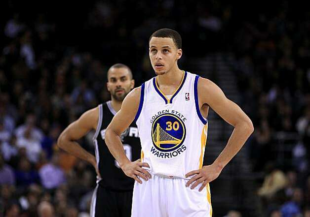OAKLAND, CA - JANUARY 24:  Stephen Curry #30 of the Golden State Warriors stands at midcourt during their game against the San Antonio Spurs at Oracle Arena on January 24, 2011 in Oakland, California.  NOTE TO USER: User expressly acknowledges and agrees that, by downloading and or using this photograph, User is consenting to the terms and conditions of the Getty Images License Agreement.  (Photo by Ezra Shaw/Getty Images) Photo: Ezra Shaw, Getty Images