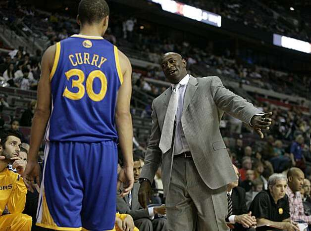 Golden State Warriors coach Keith Smart, right, gives some instructions to Stephen Curry in the second half of an NBA basketball game Sunday, Nov. 7, 2010, in Auburn Hills, Mich. (AP Photo/Duane Burleson) Photo: Duane Burleson, ASSOCIATED PRESS
