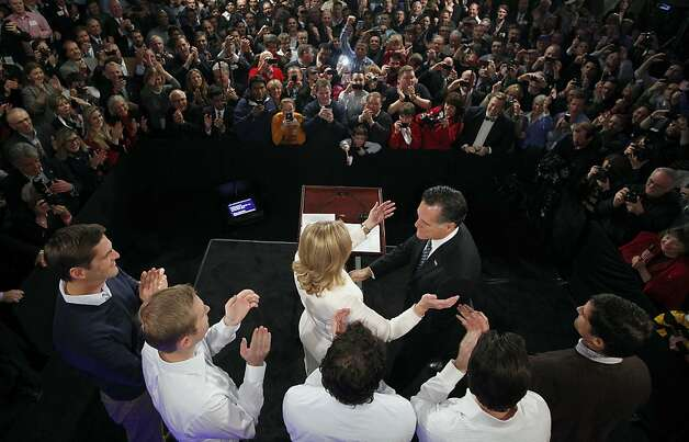 Former Massachusetts Gov. Mitt Romney reaches for his wife Ann as his sons, Josh, Ben, Craig, Tagg and Matt (L-R) look on during the Romney for President New Hampshire primary night rally at Southern New Hampshire University in Manchester, N.H., Tuesday, Jan. 10, 2012. (AP Photo/Charles Dharapak) Photo: Charles Dharapak, Associated Press