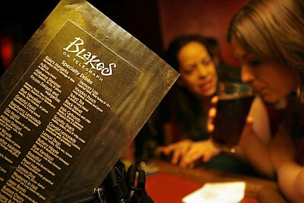 Melissa Phillips (middle), from Pt. Richmond, and Jill Gordon (right), from El Cerrito having drinks at Blake's in Berkeley in 2007.