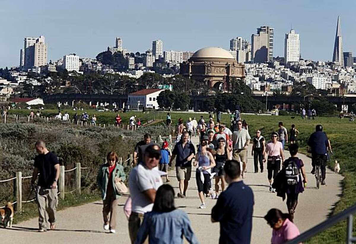 Parking areas and walkways are crowded Sunday as people follow the path around Crissy Field in San Francisco. The weather was so excellent that some locals decided to skip the Super Bowl and enjoy some surprising mild winter temperatures.