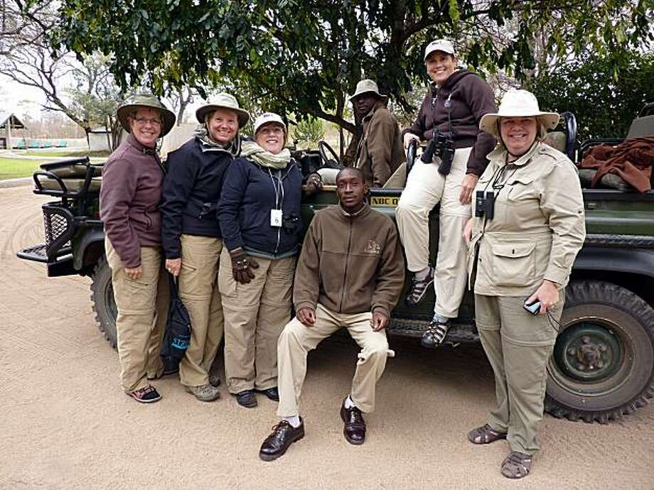 Keven Seaver of Novato with Lynn Forsey, Jan Kroeger, safari scout Rident, ranger Jeffrey, Lisa Crawley and Julie Cason at Nottens Bush Camp in South Africa. Photo: Courtesy Keven Seaver