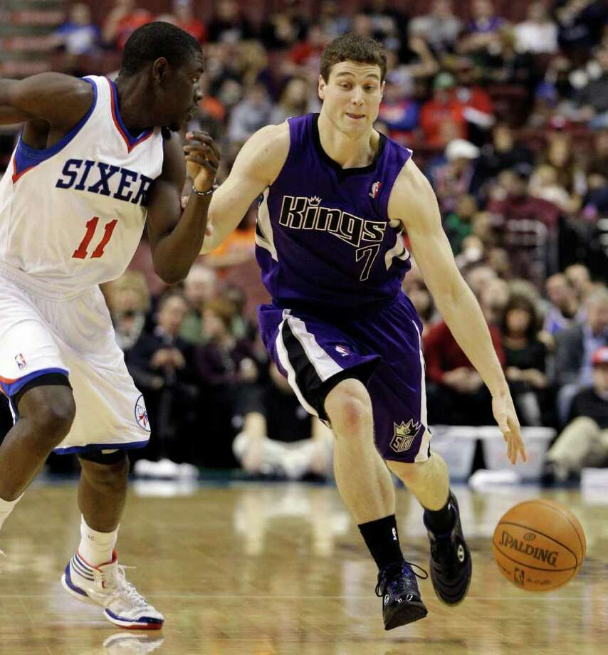 Sacramento Kings' Jimmer Fredette (7) dribbles the ball against Philadelphia 76ers' Jrue Holiday (11) in the first half of an NBA basketball game, Tuesday, Jan. 10, 2012, in Philadelphia. Philadelphia won 112-85. (AP Photo/Matt Slocum) Photo: Matt Slocum