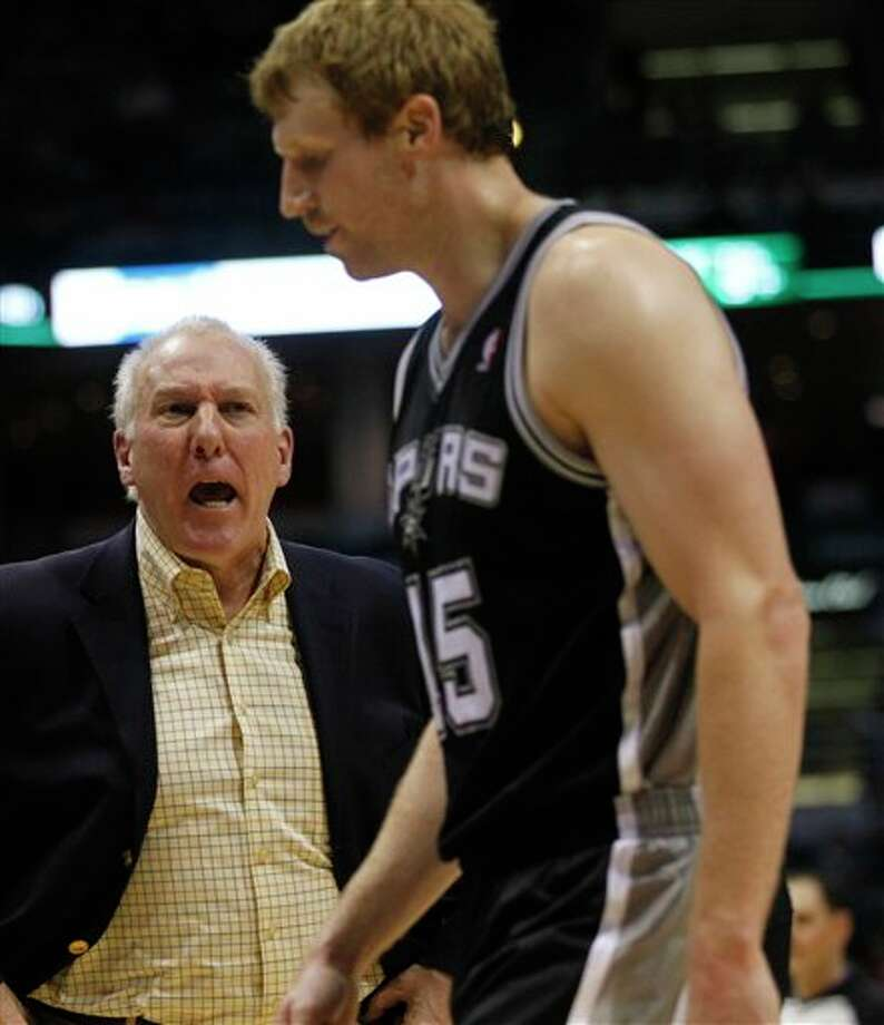 San Antonio Spurs head coach Gregg Popovich, left, yells at Matt Bonner (15) during a time out against the Milwaukee Bucks during the second half of an NBA basketball game, Tuesday, Jan. 10, 2012, in Milwaukee. The Bucks won 106-103.  (AP Photo/Jeffrey Phelps) Photo: Associated Press