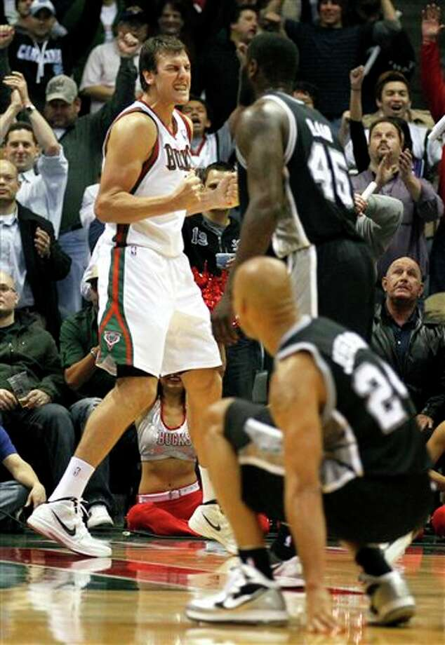 Milwaukee Bucks' Andrew Bogut, left, reacts in front of San Antonio Spurs' DeJuan Blair (45) and Richard Jefferson(24) at the end of the game in a NBA basketball game, Tuesday, Jan. 10, 2012, in Milwaukee. The Bucks won 106-103. (AP Photo/Jeffrey Phelps) Photo: Associated Press