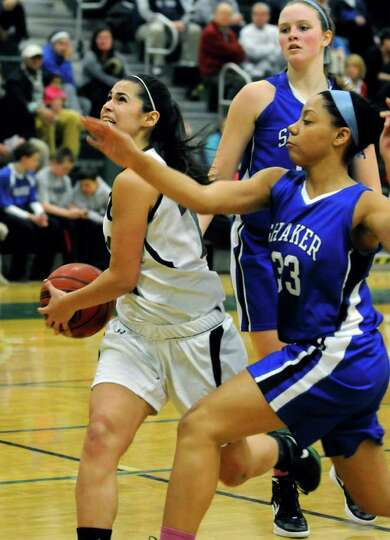 Shenendehowa's Alyssia Marsal drives to the basket defended by Shaker's MacKenzie Rowland during the