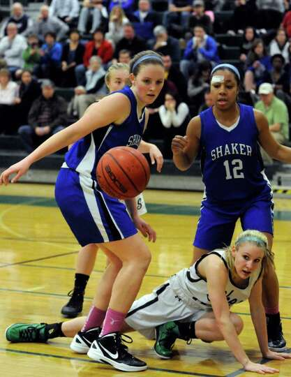 Shaker's Lauren Woods,left, and Madison Rowland watch a loose ball with Shenendehowa's Emily Weber