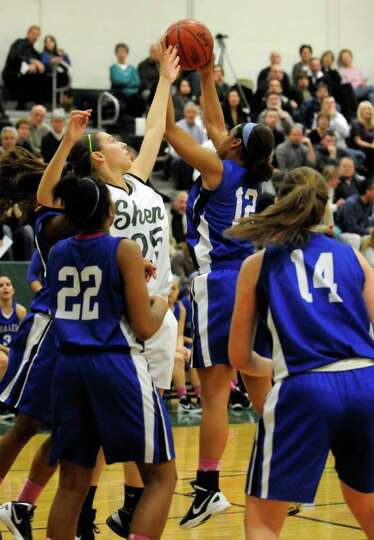 Shenendehowa's Ashley Acker and Shaker's Madison Rowland battle for a rebound during their girl's hi