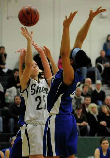 Shenendehowa's Ashley Acker puts up a shot during their girl's high school basketball game in Clifto