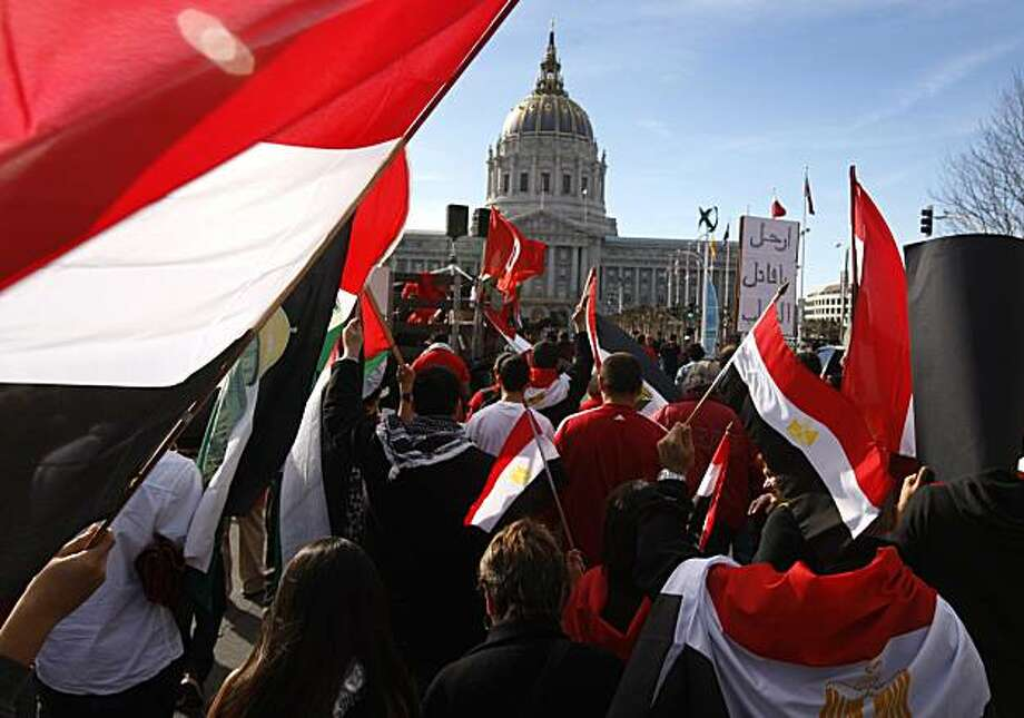 Demonstrators march toward City Hall to support the uprising in Egypt after a rally at UN Plaza in San Francisco on Saturday. Photo: Paul Chinn, The Chronicle