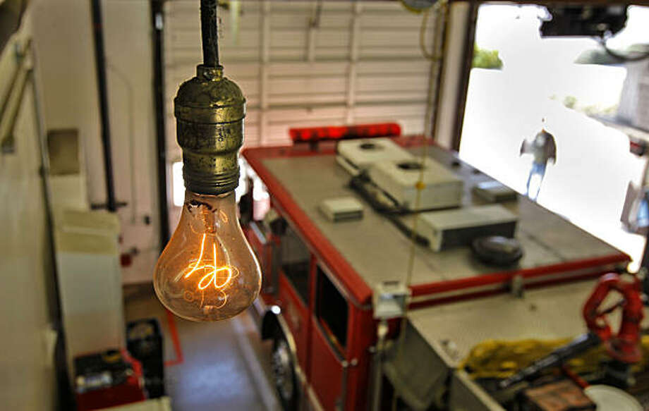 Declared the oldest known working light bulb by Guinness Book of World Records and Ripley's Believe-It-or-Not in 1972, the centennial bulb hangs from the ceiling of Livermore Fire Station #6 on Thursday Feb. 3, 2011, in Livermore, Ca. The light bulb was first switched on at fire department hose cart house on L Street  in Livermore in 1901. Photo: Michael Macor, The Chronicle