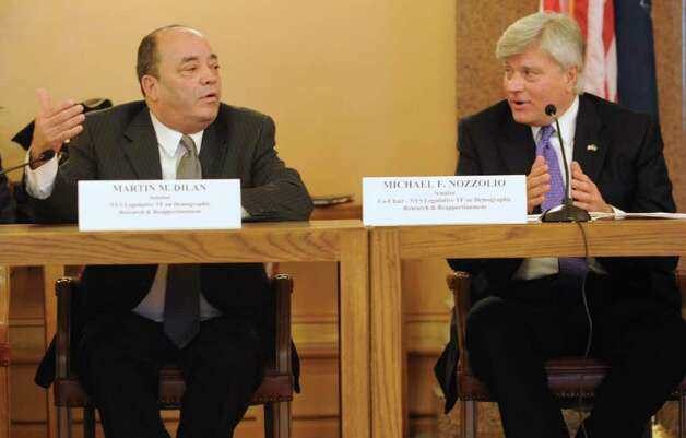 From left, Senator Martin Dilan and Senator Michael Nozzolio argue and issue as members of the Task Force on Demographic Research and Reapportionment meet to discuss redistricing plans at the Capitol Tuesday, Jan. 10, 2012 in Albany, N.Y. The task force plans to increase the size of the state Senate to 63 by adding 1 new seat. NY will also lose 2 seats in Congress. (Lori Van Buren / Times Union) Photo: Lori Van Buren