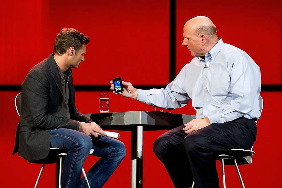 Steve Ballmer, chief executive officer of Microsoft Corp., right, shows host Ryan Seacrest the Nokia Lumia 710 phone at the 2012 International Consumer Electronics Show (CES) in Las Vegas, Nevada, U.S., on Monday, Jan. 9, 2012. Nokia Oyj and Microsoft Corp. unveiled their first high-speed Windows Phone for AT&T Inc. at the Consumer Electronics Show, aiming to help both companies stage a comeback in the smartphone industry. Photographer: David Paul Morris/Bloomberg *** Local Caption *** Steve Ballmer; Ryan Seacrest Photo: David Paul Morris, Bloomberg