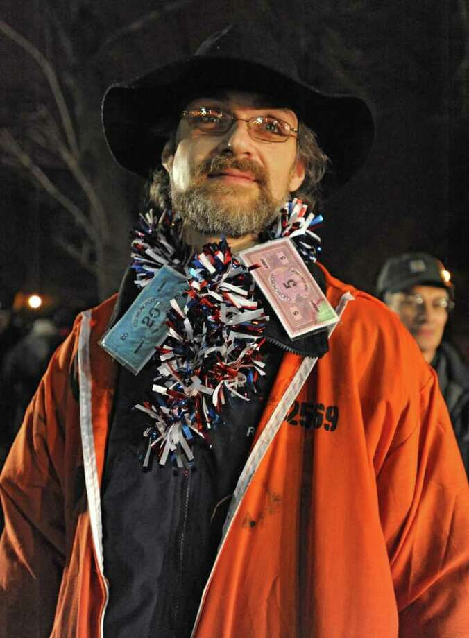 Occupy Albany member Bradley Russell of Albany was one of the people sprayed with pepper spray by an Albany policeman after DGS workers took down the last tents in Academy Park on Thursday, Dec. 22, 2011 in Albany, N.Y.  (Lori Van Buren / Times Union) Photo: Lori Van Buren
