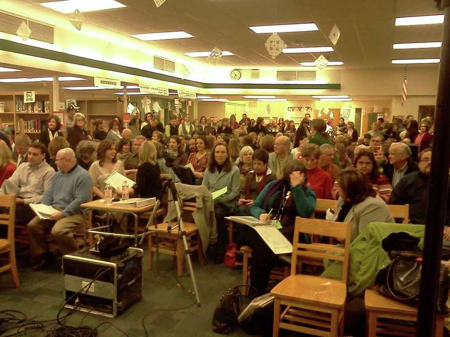 More than 200 people crammed into a Shenendehowa school library for Tuesday's Board of Education meeting.