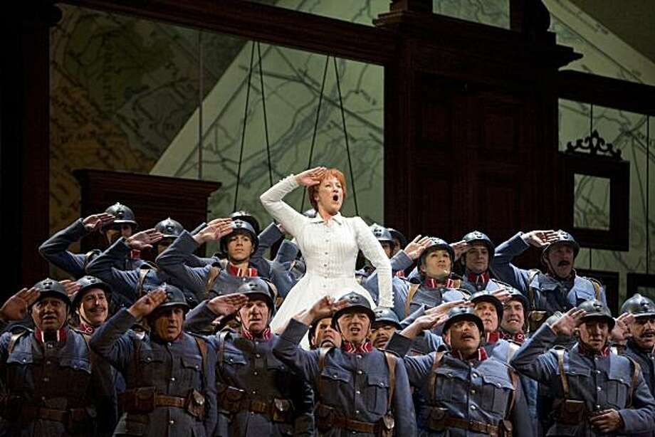 "Diana Damrau (Marie) and soldiers of the 21st Regiment in Donizetti's ""Daughter of the Regiment"" at San Francisco Opera Photo: Cory Weaver"