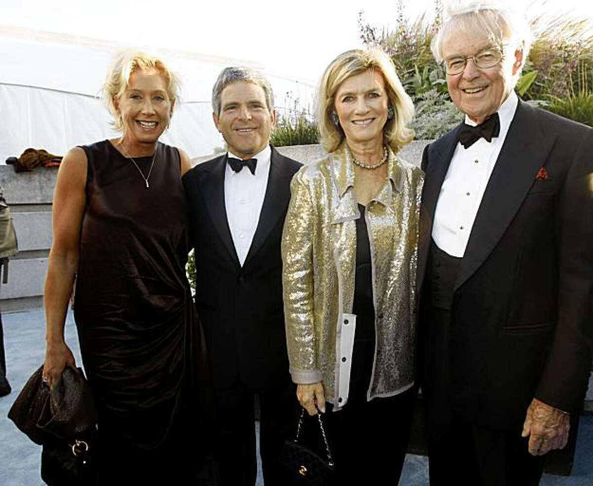 Lori Bonn and Joshua Robison (left) and Gretchen and Howard Leach (right) at the Symphony Gala at Davies Hall on Wednesday, September 8, 2009, in San Francisco, Calif.