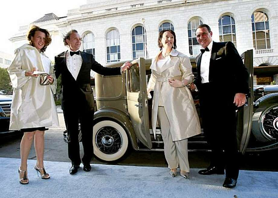 Gina Gallo (left), JC Boisset, Academy of Art University President Elisa Stephens and her husband, Ed Conlon ,(right) emerge from a 1931 Chrysler at the gala. Davies Symphony Hall was the scene of the opening of the San Francisco Symphony season with much celebration and plenty of well dressed locals. Photo: Brant Ward, The Chronicle