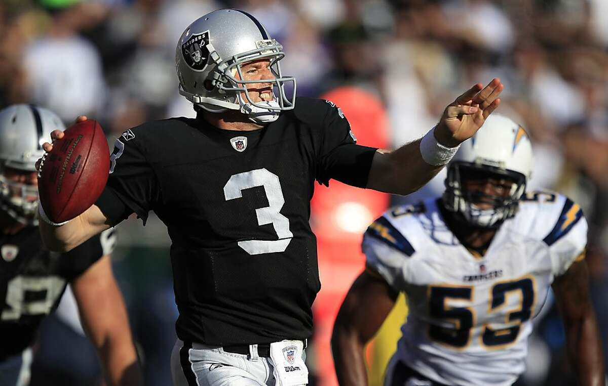 Oakland Raiders quarterback Carson Palmer (3) passes against the San Diego Chargers during the second quarter of an NFL football game in Oakland, Calif., Sunday, Jan. 1, 2012. (AP Photo/Marcio Jose Sanchez)