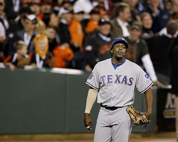 Vladimir Guerrero walks back to his position in the 8th inning after mishandling a hit by Freddy Sanchez. The San Francisco Giants defeated the Texas Rangers 11-7 in the first game of the 2010 World Series. Photo: Brant Ward, San Francisco Chronicle