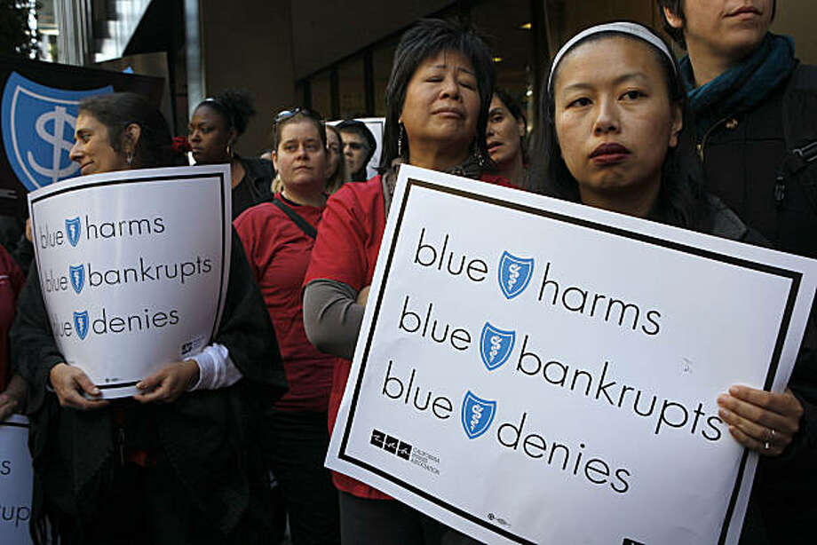 Karen Chan (right) from the California Nurses Assoc. (CNA) listens to speakers protesting recent Blue Shield rate hikes, of up to 59 percent for individuals,  in San Francisco Calif., on Tuesday, February 1, 2011. Photo: Liz Hafalia, The Chronicle