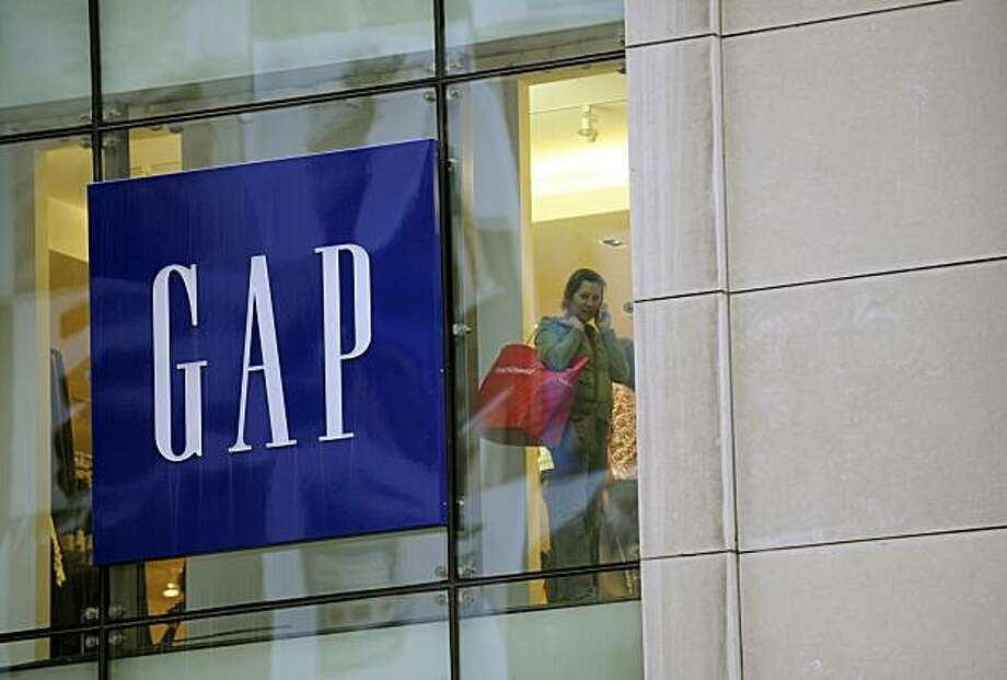 (FILES) A woman shops at a GAP store in New York, November 14, 2008. US clothing giant Gap has shelved a new version of its trademark blue-and-white logo, after the attempted rebranding sparked a firestorm of online protests, the company said October 11,2010. The California-based retailer, which sells clothes around the world, introduced the new logo only a week ago, replacing its distinctive tall upper-case Gap lettering in white on a blue square background. Photo: Emmanuel Dunand, AFP/Getty Images