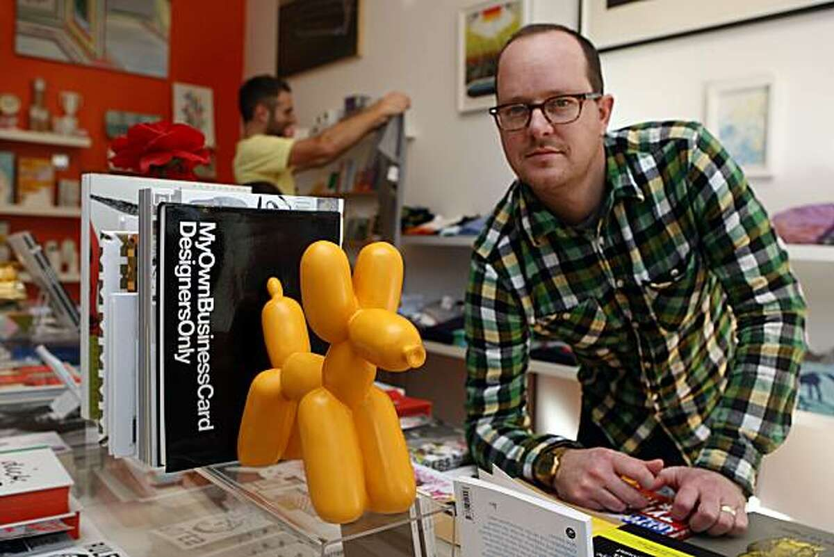 Owner Jamie Alexander (right) of Park Life store and gallery next to the balloon dog bookend at his store in San Francisco, Calif., on Tuesday, January 25, 2011.