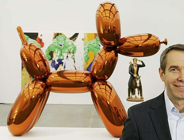 "Contemporary artist Jeff Koons poses beside ""Balloon Dog,"" one of his most famous works on display at Chicago's Museum of Contemporary Art Thursday, May 29, 2008. The more than 10-foot-high chromium stainless steel sculpture of a balloon-animal dog has an orange metallic coating is part of an exhibit of about 60 other sculptures and paintings by Koons. The exhibit, Koons' first major U.S. exhibit in nearly 15 years, runs from Saturday, May 31 through late September 2008. (AP Photo/Charles Rex Arbogast) Photo: Charles Rex Arbogast, AP"
