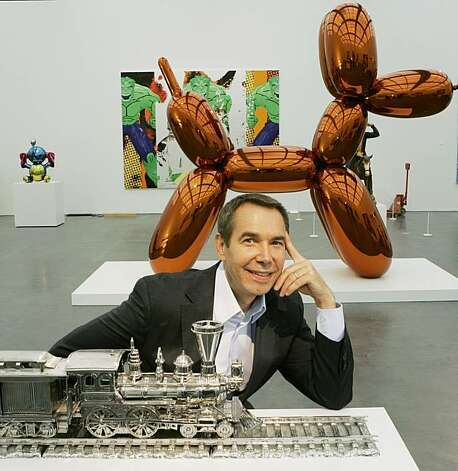"Artist Jeff Koons poses in front of ""Balloon Dog,"" background and a section of the stainless steel ""Jim Beam - J.B. Turner Train,"" foreground, on display at Chicago's Museum of Contemporary Art. The more than 10-foot-high chromium stainless steel sculpture of a balloon-animal dog has an orange metallic coating is part of an exhibit of about 60 other sculptures and paintings by Koons. Chicago, Thursday, May 29, 2008. Photo: Charles Rex Arbogast, AP"