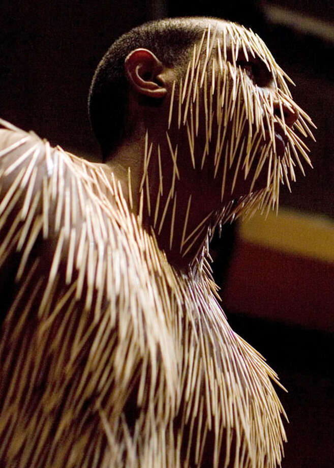 Covered by toothpicks, an artist performs during the opening night of the 5th World Meeting of Body Art in Caracas, Venezuela, Friday, Oct. 15, 2010. Activities such as body painting, modifications, tattoos, suspension rituals, performances, dance, workshops and conferences are being presented during the event. Photo: Ariana Cubillos, AP