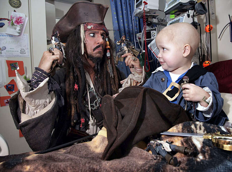 Brendan Anderson, 41, impersonates pirate captain Jack Sparrow during a visit to the University of Minnesota Amplatz Children's Hospital in Minneapolis, Minn., on Saturday Oct. 16, 2010 to visit Nicholas Koenig, 3. Photo: Paul M. Walsh, The Country Today