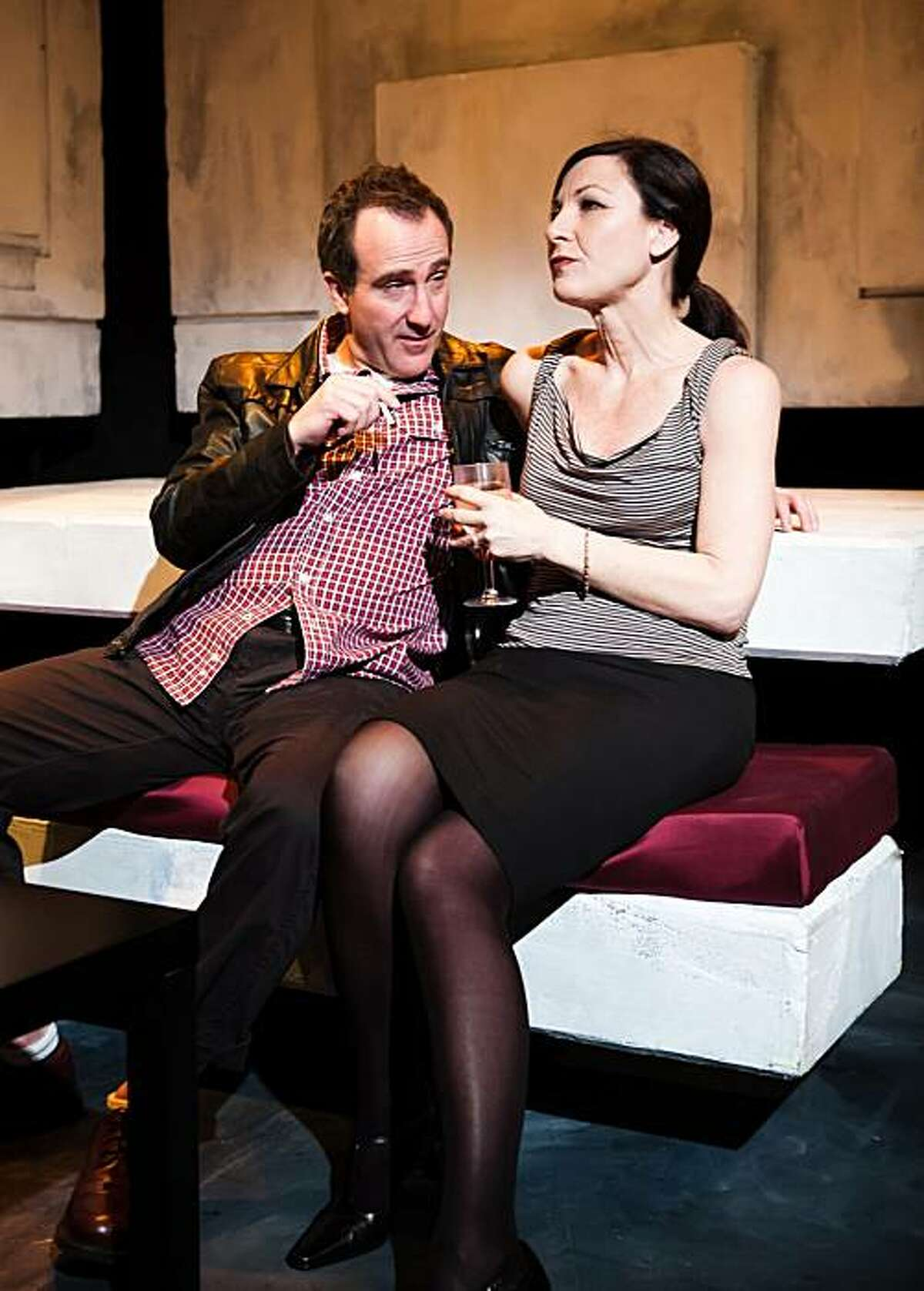 Harper (Susi Damilano) seeks solace from a stranger (Richard Frederick) in SF Playhouse's West Coast premiere of