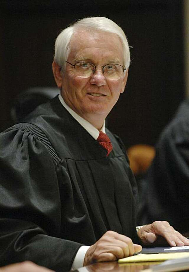 In a July 27, 2007 photo, Senior U.S. District Judge Roger Vinson speaks to candidates for citizenship during a naturalization ceremony at the U.S. District Court in Pensacola, Fla.  Vinson declared the Obama administration's health care overhaul unconstitutional Monday, Jan. 31, 2011, siding with 26 states that sued to block it, saying that people can't be required to buy health insurance. Photo: Ben Twingley, AP