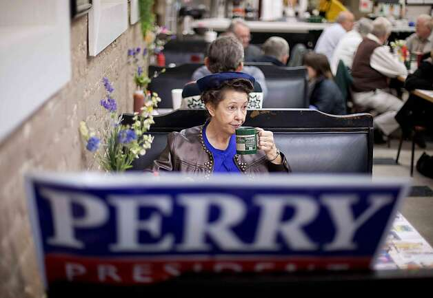 Shirley Ann Jackson of Rock Hill. S.C., sips her coffee at Kinch's restaurant in Rock Hill, S.C., Tuesday, Jan. 10, 2012, while waiting for the start of a campaign event with Republican presidential candidate, Texas Gov. Rick Perry. (AP Photo/David Goldman) Photo: David Goldman, Associated Press