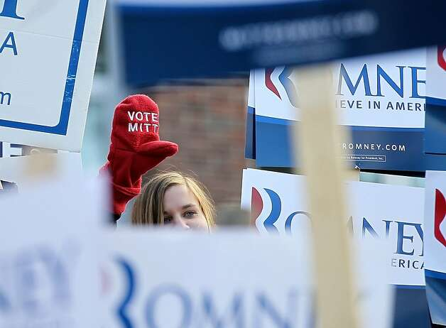 MANCHESTER, NH - JANUARY 10:  A supporter of republican presidential hopeful and former Massachsetts Gov. Mitt Romney stands between campaign signs outside of the Webster School polling station on January 10, 2012 in Manchester, New Hampshire. Voters in New Hampshire headed to the polls in the nation's first primary election to pick their choice for a U.S. presidential candidate.   (Photo by Justin Sullivan/Getty Images) *** BESTPIX *** Photo: Justin Sullivan, Getty Images