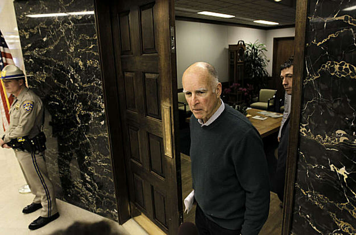 Governor Jerry Brown, at the front entrance of his new office at the State Capital building in Sacramento, Ca., on Friday Jan. 28, 2011. Governor Brown is settling into his new office in the Capital building.