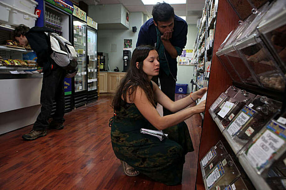Board member Carolina Rodriguez (front) works on catering while making a list of grocery items with Ernest Martinez (middle) at the Berkeley Student Food Collective across from the UC Berkeley Campus in Berkeley, Calif., on Monday, January 24, 2011. Photo: Liz Hafalia, The Chronicle