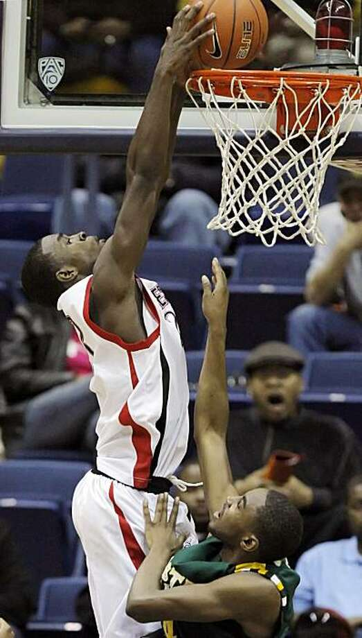 Salesian's Jabari Bird dunks the ball over Castro Valley's Chris Read in the second half. The Salesian Pride takes on the Castro Valley Trojans as part of the Martin Luther King Classic basketball tournament at Haas Pavilion on the UC Berkeley Campus in Berkeley, Calif., on Monday, January 17, 2011. Photo: Carlos Avila Gonzalez, The Chronicle