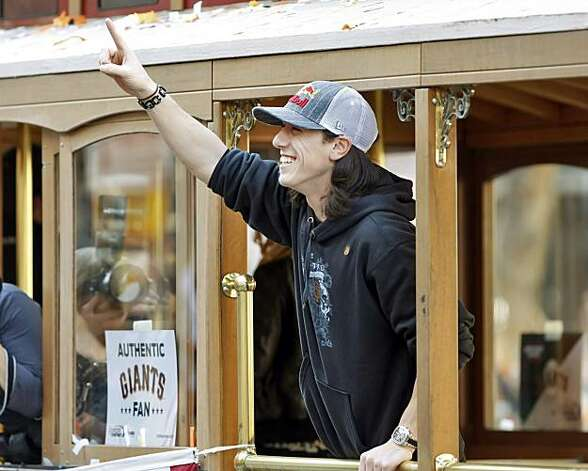 Tim Lincecum points to the crowd gathered during the parade. The city of San Francisco held a victory parade for the World Champion San Francisco Giants on Wednesday, November 3, 2010, two days after the team won the World Series against the Texas Rangers. The parade came down Market Street in San Francisco, Calif., and was the same route taken by the parade welcoming the Giants to San Francisco in 1958 when they moved from New York to the west coast. Photo: Carlos Avila Gonzalez, San Francisco Chronicle