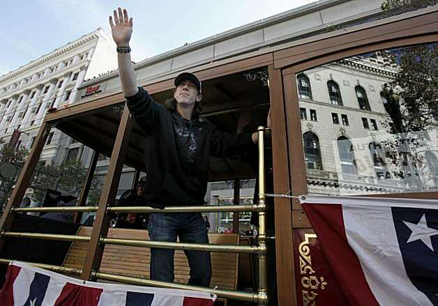 Tim Lincecum waved at his legion of fans on Market Street Wednesday November 3, 2010. Thousands of San Francisco Giant fans attended a parade in downtown San Francisco, Calif. celebrating the teams World Series victory. Photo: Brant Ward, The Chronicle