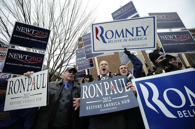 TOPSHOTS Supporters of Republican presidential hopefuls hold placards outside a polling station at Webster School in Manchester, New Hampshire, January 10, 2012.  New Hampshire will hold its Republican primary on January 10, 2012.   TOPSHOTS/AFP PHOTO/Emmanuel Dunand (Photo credit should read EMMANUEL DUNAND/AFP/Getty Images) Photo: Emmanuel Dunand, AFP/Getty Images