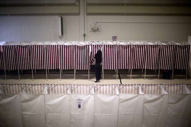 Voters cast ballots in the gym of the Webster School in Manchester, N.H., Tuesday, Jan. 10, 2012.  (AP Photo/Evan Vucci) Photo: Evan Vucci, Associated Press