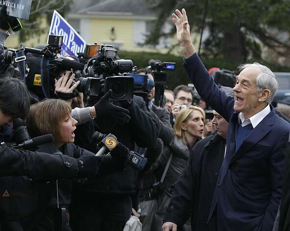 Republican presidential candidate, Rep. Ron Paul, R-Texas waves outside the Webster School polling place in Manchester, N.H., Tuesday afternoon, Jan. 10, 2012. (AP Photo/Stephan Savoia) Photo: Stephan Savoia, Associated Press