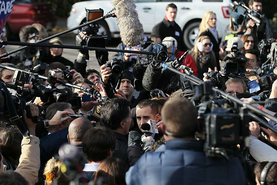 MANCHESTER, NH - JANUARY 10:  Republican presidential hopeful and former Massachusetts Gov. Mitt Romney (C) struggles to get through a crowd of media to his car after greeting supporters outside of the Webster School polling station on January 10, 2012 in Manchester, New Hampshire. Voters in New Hampshire headed to the polls in the nation's first primary election to pick their choice for a U.S. presidential candidate.   (Photo by Justin Sullivan/Getty Images) Photo: Justin Sullivan, Getty Images