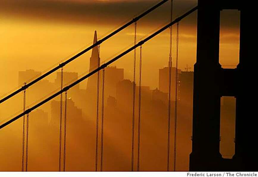 The sunrise over the Bay Bridge is seen from the Marin Headlands.