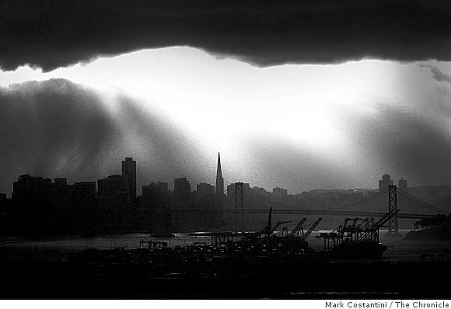 Storm clouds gather over the Golden Gate Bridge on February 21, 2007 as seen from this view from the Piedmont hills. Photo: Mark Costantini, The Chronicle