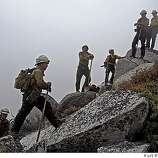 The members of the Firestorm crew standing on the side of Shasta Bally at 6000 ft. in the smoke filled air. They head off to another hot spot on the mountain on Friday, July 18,  2008 in Whiskeytown, Calif.