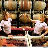 Lauren Wood (left) and Zoe Miller (right), give a toast during Stomp Out Breast Cancer at Amphora Wines in Healdsburg, Calif., on September 13, 2008. Winery owner and winemaker, Rick Hutchinson, has this grape stomp every year during harvest time to raise money for breast cancer prevention.