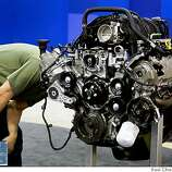 Martin Roger moves in for a close inspection of a Ford V8 engine at the 51st annual International Auto Show in San Francisco, Calif., on Saturday, Nov. 22, 2008.